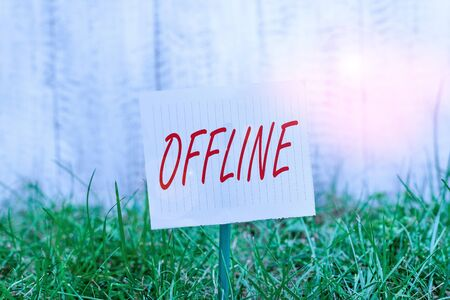 Word writing text Offline. Business photo showcasing Not having directly connected to a computer or external network Plain empty paper attached to a stick and placed in the green grassy land