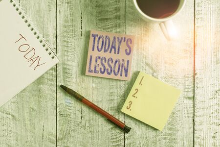 Conceptual hand writing showing Today S Is Lesson. Concept meaning ask assigned for individual study Something to be learned Stationary placed next to a coffee cup above wooden table