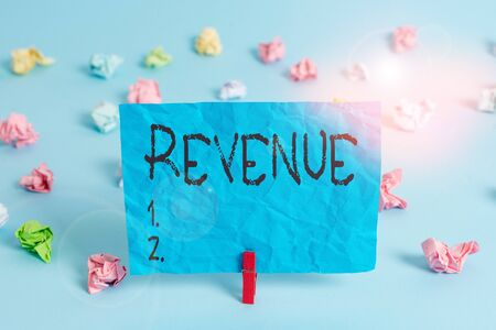 Handwriting text writing Revenue. Conceptual photo total amount of income generated by the sale of goods or services Colored crumpled rectangle shaped reminder paper light blue background