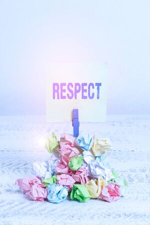 Word writing text Respect. Business photo showcasing Feeling of deep admiration for someone or something Appreciation Reminder pile colored crumpled paper clothespin reminder white wooden space