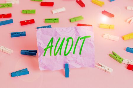 Word writing text Audit. Business photo showcasing Distinctive typically pleasant smell Subtle of a particular type Colored clothespin papers empty reminder pink floor background office pin
