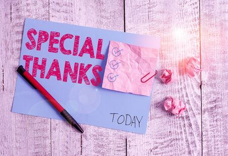 Conceptual hand writing showing Special Thanks. Concept meaning expression of appreciation or gratitude or an acknowledgment Wrinkle paper and cardboard placed above wooden background