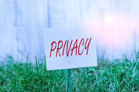 Word writing text Privacy. Business photo showcasing Right to keep demonstratingal matters and information as a secret Plain empty paper attached to a stick and placed in the green grassy land