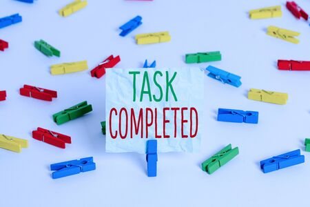 Handwriting text Task Completed. Conceptual photo Finished action or assignments that has no remaining duration Colored clothespin papers empty reminder white floor background office