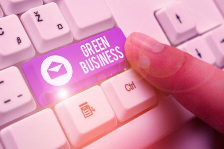 Writing note showing Green Business. Business concept for company that does not make negative impact on the environment