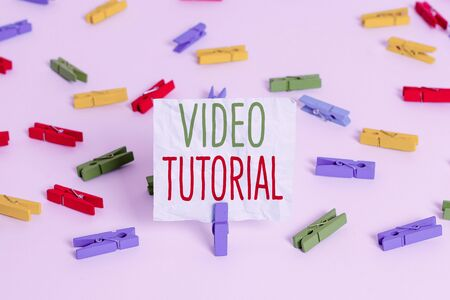 Handwriting text Video Tutorial. Conceptual photo method of transferring knowledge through audiovisual clips Colored clothespin papers empty reminder white floor background office