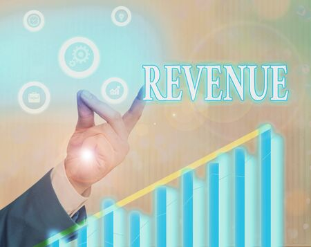 Writing note showing Revenue. Business concept for total amount of income generated by the sale of goods or services