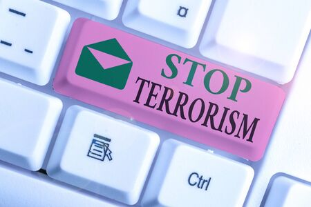 Conceptual hand writing showing Stop Terrorism. Concept meaning Resolving the outstanding issues related to violence