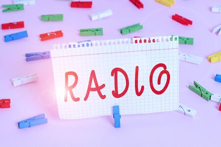 Handwriting text Radio. Conceptual photo activity or industry of broadcasting sound programmes to the public Colored clothespin papers empty reminder pink floor background office pin Stock fotó