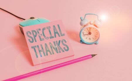 Word writing text Special Thanks. Business photo showcasing expression of appreciation or gratitude or an acknowledgment Vintage alarm clock wire mouse empty notepad markers colored background Banco de Imagens
