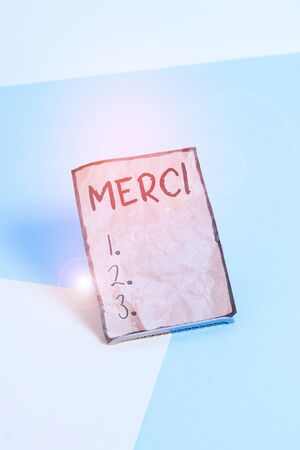 Writing note showing Merci. Business concept for what is said or response when someone helps you in France Thank you Paper on buffer wire on soft pastel multi colours backdrop