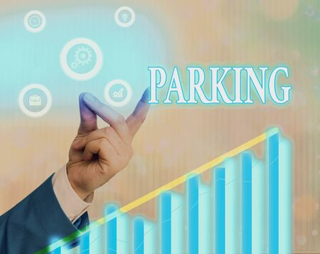 Writing note showing Parking. Business concept for leaving a vehicle in a particular place for a period of time