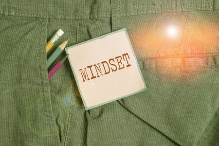 Handwriting text writing Mindset. Conceptual photo the mental and emotional attitude that focuses on bright side Writing equipment and pink note paper inside pocket of man work trousers