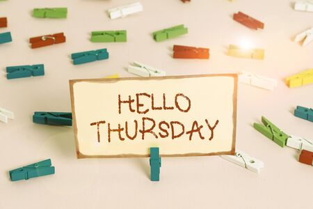 Handwriting text Hello Thursday. Conceptual photo the greeting used to welcome the day after wednesday Colored clothespin papers empty reminder pink floor background office pin Reklamní fotografie