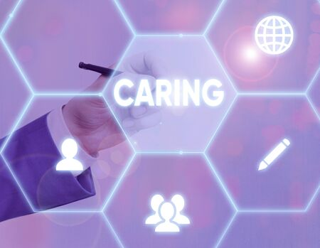 Text sign showing Caring. Business photo showcasing practice of looking after those unable to care for themselves Zdjęcie Seryjne
