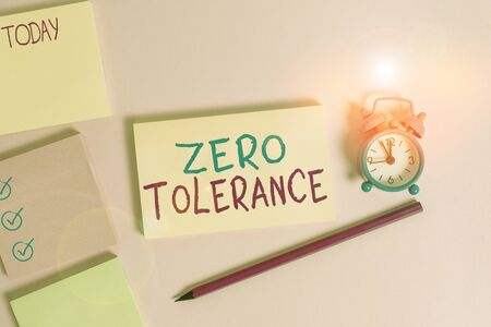 Conceptual hand writing showing Zero Tolerance. Concept meaning refusal to accept antisocial behaviour or improper behaviour Four multicolor notepads marker alarm clock color background Banque d'images