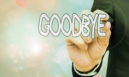 Text sign showing Goodbye. Business photo showcasing used to express good wishes when parting or end of a conversation Zdjęcie Seryjne