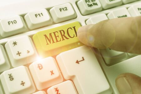 Word writing text Merci. Business photo showcasing what is said or response when someone helps you in France Thank you