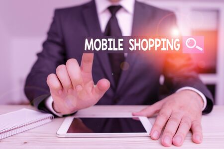 Writing note showing Mobile Shopping. Business concept for trading of goods and services through wireless devices Male human wear formal clothes present use hitech smartphone
