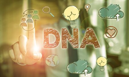 Writing note showing Dna. Business concept for a selfreplicating material wpresent in nearly all living organisms