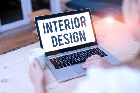 Conceptual hand writing showing Interior Design. Concept meaning the art of designing the interior decoration of a building