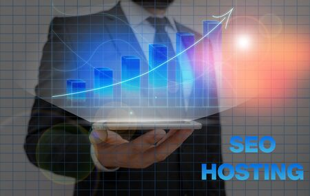Writing note showing Seo Hosting. Business concept for building website in a way that is friendly for search engines
