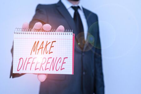 Text sign showing Make Difference. Business photo text to cause a change To be important or significant in some way Male human wear formal work suit office look hold mathematics book use hand 스톡 콘텐츠