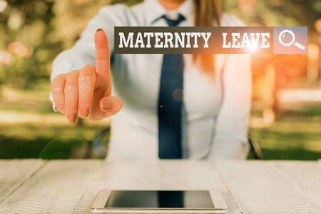 Word writing text Maternity Leave. Business photo showcasing the leave of absence for an expectant or new mother Female business person sitting by table and holding mobile phone