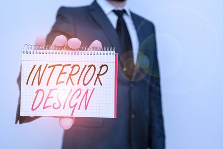 Text sign showing Interior Design. Business photo text the art of designing the interior decoration of a building Male human wear formal work suit office look hold mathematics book use hand