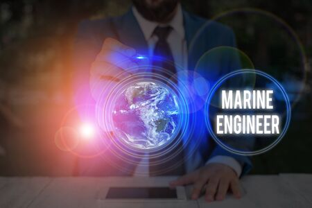 Writing note showing Marine Engineer. Business concept for in charge with maintenance and operation of a ship s is engines Standard-Bild