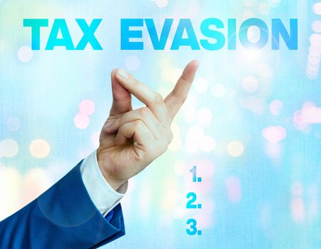 Writing note showing Tax Evasion. Business concept for the failure to pay or the deliberate underpayment of taxes