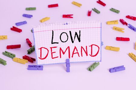 Text sign showing low demand. Business photo showcasing less consumer s is desire to purchase goods and services Colored clothespin papers empty reminder white floor background office