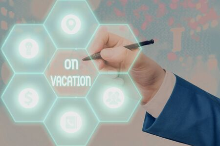 Writing note showing On Vacation. Business concept for period spent away from home or business in travel or recreation
