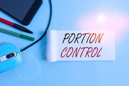 Text sign showing Portion Control. Business photo showcasing knowing the correct measures or serving sizes as per calorie Notebook and writing equipment with modern gadget above pastel backdrop