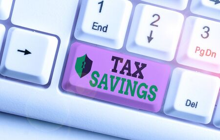 Text sign showing Tax Savings. Business photo showcasing only a portion of income is taxable Pay a reduced amount of tax