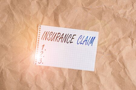 Text sign showing Insurance Claim. Business photo showcasing coverage or compensation for a covered loss or policy event Papercraft craft paper desk square spiral notebook office study supplies