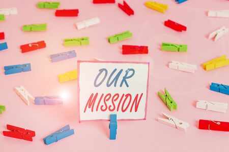 Conceptual hand writing showing Our Mission. Concept meaning A written declaration of an organization s is core purpose Colored clothespin papers empty reminder pink floor office Stock fotó