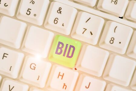 Writing note showing Bid. Business concept for to offer a particular amount of money for something that is for sale