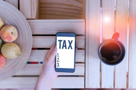 Text sign showing Tax. Business photo showcasing Compulsory contribution to state revenue Levy impose by government Reklamní fotografie