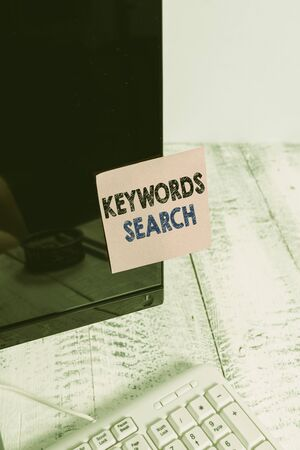 Conceptual hand writing showing Keywords Search. Concept meaning looks for matching documents that contain one or more words Notation paper computer monitor screen near white keyboard