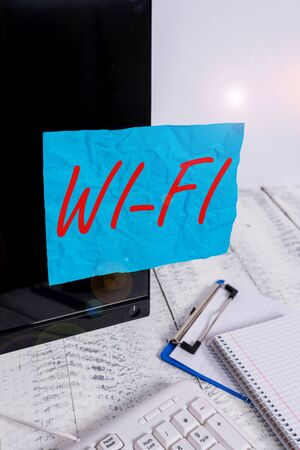 Text sign showing Wi Fi. Business photo showcasing radio technologies commonly used for wireless local area networking Note paper taped to black computer screen near keyboard and stationary
