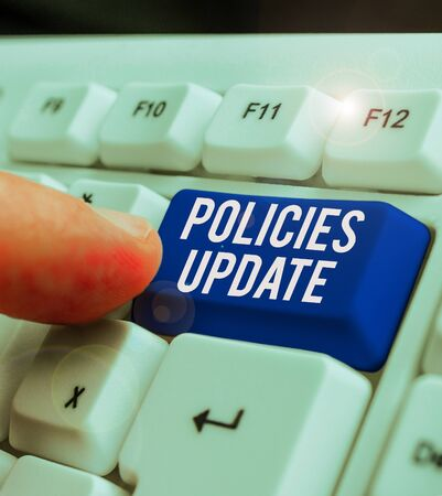 Conceptual hand writing showing Policies Update. Concept meaning act of adding new information or guidelines formulated Banque d'images