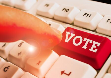 Text sign showing Vote. Business photo text Act of expressing a formal indication of choice Majority wins Stock Photo