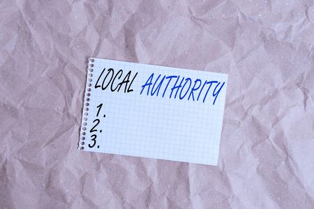 Text sign showing Local Authority. Business photo showcasing the group of showing who govern an area especially a city Papercraft craft paper desk square spiral notebook office study supplies