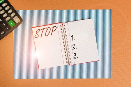 Writing note showing Stop. Business concept for Come to an end Prevent Take action to an event from happening Striped paperboard notebook cardboard office study supplies chart paper