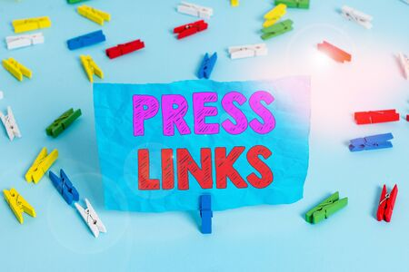 Word writing text Press Links. Business photo showcasing intended to manipulate a site s is ranking in Google search Colored clothespin papers empty reminder blue floor background office pin
