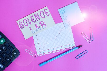 Handwriting text writing Science Lab. Conceptual photo special facility where experiments are done and with equipment Stationary and note paper plus math sheet with diagram picture on the table