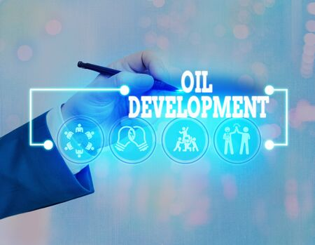 Conceptual hand writing showing Oil Development. Concept meaning act or process of exploring an area on land or sea for oil Stock fotó