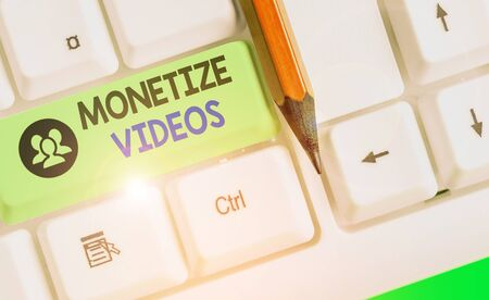 Conceptual hand writing showing Monetize Videos. Concept meaning process of earning money from your uploaded YouTube videos