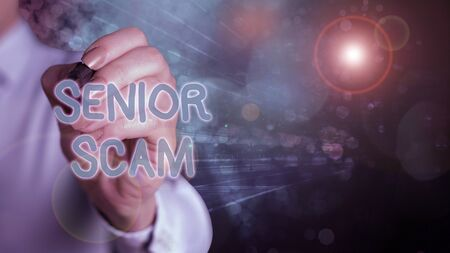 Writing note showing Senior Scam. Business concept for fraud schemes targeting the lifestyle and savings of the elderly